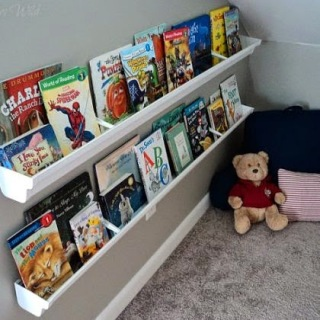 http://www.restorationbeauty.com/2013/04/rain-gutter-bookshelves.html