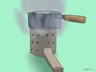 http://www.wikihow.com/Make-a-Tin-Can-Camp-Stove-%28Hobo-Stove%29