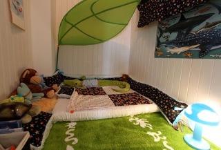 http://offbeatfamilies.com/2011/07/toddler-bed-floor-mattress